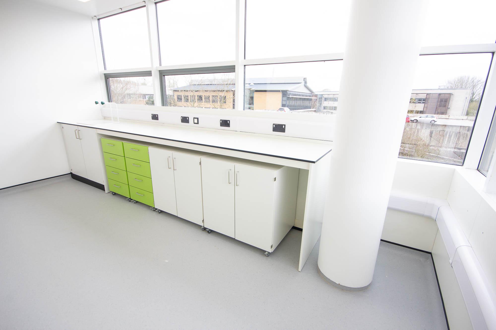 C5218 - Evox Therapeutics - Lab Workspace Plug Sockets Cabinets Drawers